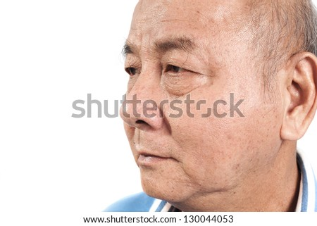 Closeup portrait of an elderly bald man on white background