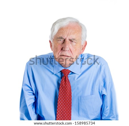 Closeup portrait of an elderly executive, grandfather, looking unhappy and annoyed, having trouble hearing his partner, during unpleasant conversation, isolated on a white background . Geriatrics - stock photo