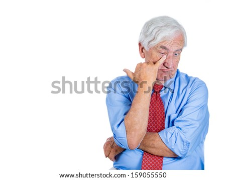 Closeup portrait of an elderly executive, old corporate employee, grandfather in melancholic mood, daydreaming, looking sad about to cry, isolated on white background with copy space. Human emotions. - stock photo