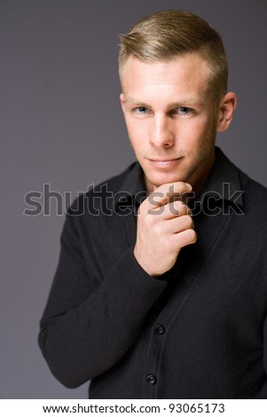 Closeup portrait of an elegantly dressed handsome young man with thinking gesture. - stock photo
