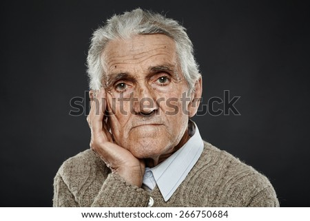 Closeup portrait of an expressive senior man with white hair - stock photo