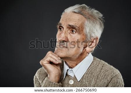 Closeup portrait of an expressive senior man with white hair - stock photo