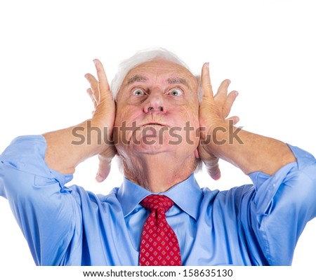 Closeup portrait of an old man, grandfather, corporate executive in blue shirt and red tie covering his ears from loud noise, having a headache isolated on white background.Conflict resolution. - stock photo