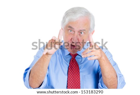 Closeup portrait of an unhappy senior man, executive, grandpa, having an argument with someone and trying to blame him or prove opponent is wrong , Isolated on white background. Conflict resolution. - stock photo