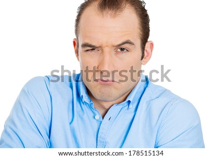 Closeup portrait of angry, mad, annoyed, skeptical, grumpy business man, employee, worker isolated on white background. Human emotions, face expressions, reaction, interpersonal conflict resolution - stock photo