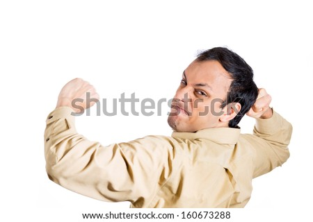 Closeup portrait of angry, mad, furious man, worker, employee, businessman in brown shirt raising fists about to hit you, at camera gesture, isolated on white background. Human emotions - stock photo