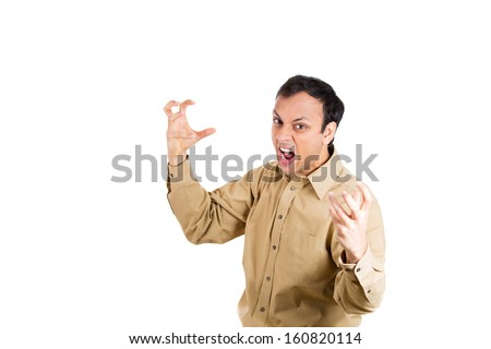 Closeup portrait of angry, mad, furious man, worker, employee, businessman in brown shirt raising hands up about to lose his temper, at camera gesture, isolated on white background. Human emotions - stock photo