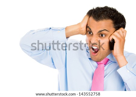 Closeup portrait of angry man shouting while on phone, isolated on white background with copy space to left - stock photo