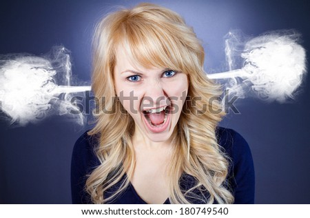 Closeup portrait of angry, pissed off, upset, mad business woman, student screaming steam going out from ears, isolated on blue, black background. Negative human face expressions, emotions, reaction - stock photo