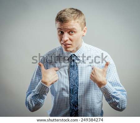 Closeup portrait of angry, unhappy, annoyed young man, getting mad, asking question: you talking to me, you mean me? Isolated on white background. Negative human emotion, facial expression, feelings - stock photo