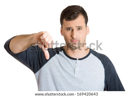 Closeup portrait of angry, unhappy, young handsome man showing thumbs down sign, in disapproval of offer, situation, isolated on white background. Negative human emotions, facial expressions, feelings