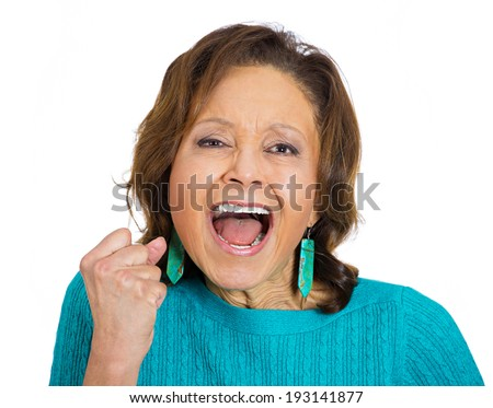 Closeup portrait of angry, upset senior mature woman worker, employee, business woman fist in air, open mouth yelling isolated on white background. Negative emotions, facial expression reaction