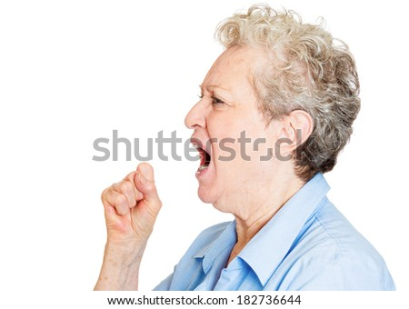 Closeup portrait of angry, upset senior mature woman worker, employee, business woman fists in air, open mouth yelling isolated on white background. Negative emotions, facial expression reaction - stock photo