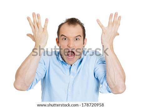 Closeup portrait of angry upset young man, worker, employee, funny looking business man arms in air open mouth yelling isolated on white background. Negative human emotion, facial expression, reaction - stock photo