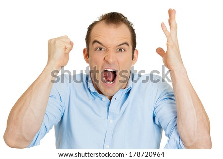 Closeup portrait of angry upset young man, worker, mad employee, funny looking business man, fist in air, open mouth yelling, isolated on white background. Negative emotion facial expression, reaction - stock photo