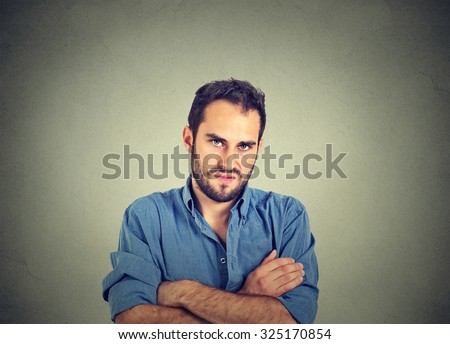 Closeup portrait of angry young man, about to have nervous breakdown, isolated on gray wall background. Negative human emotions facial expression feelings attitude - stock photo