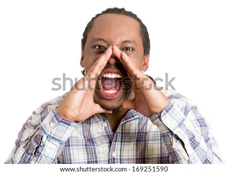 Closeup portrait of angry young man with hands raised open mouth yelling, isolated on white background. Negative emotion facial expression feelings. Conflict problems and issues