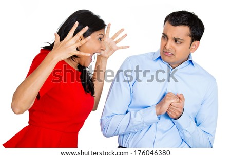 Closeup portrait of angry young woman screaming yelling shouting at scared afraid in fear face man, isolated on white background. Negative emotion facial expression feelings, reaction, situation. - stock photo
