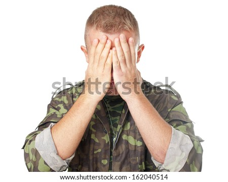 Closeup portrait of army soldier closing eyes with hands isolated on white background