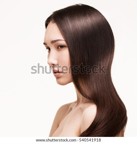 closeup portrait of asian girl with long straight hair isolated on white background