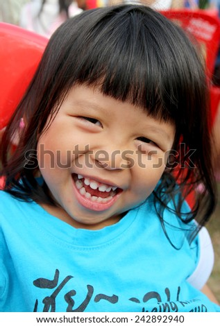 Closeup portrait of Asian little girl smiling