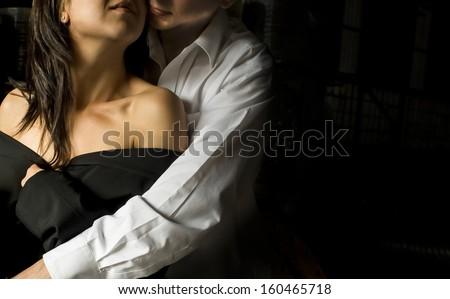 Closeup portrait of attractive caucasian couple in intimate embrace - stock photo