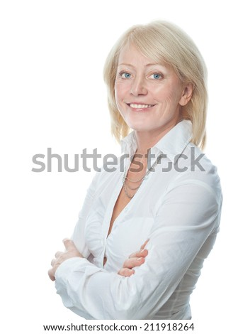 closeup portrait of attractive  caucasian smiling mature woman blond isolated on white studio shot toothy smile face hair head and shoulders looking at camera businesswoman - stock photo