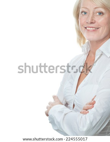 closeup portrait of attractive  caucasian smiling mature woman blond isolated on white studio shot toothy smile face hair head and shoulders looking at camera businesswoman