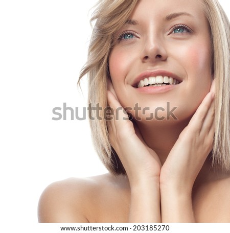 closeup portrait of attractive  caucasian smiling woman blond isolated on white studio shot lips toothy smile face hair head and shoulders looking up blue eyes teeth - stock photo