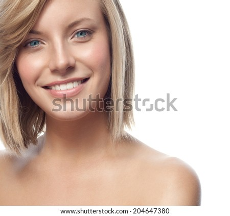 closeup portrait of attractive  caucasian smiling woman blond isolated on white studio shot lips toothy smile face hair and shoulders looking at camera blue eyes tooth