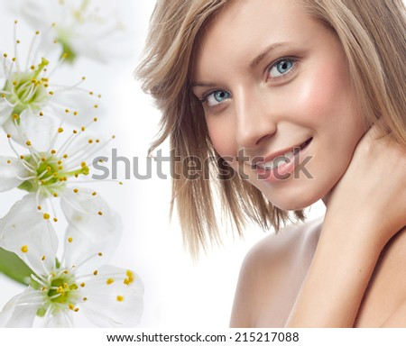 closeup portrait of attractive  caucasian smiling woman blond isolated on white studio shot lips toothy smile face hair head and shoulders looking at camera blue eyes tooth flowers aroma spring - stock photo