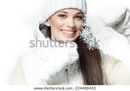 closeup portrait of attractive  caucasian smiling woman brunette isolated on white studio shot toothy smile face hair head and shoulders looking at camera warm clothing winter christmas