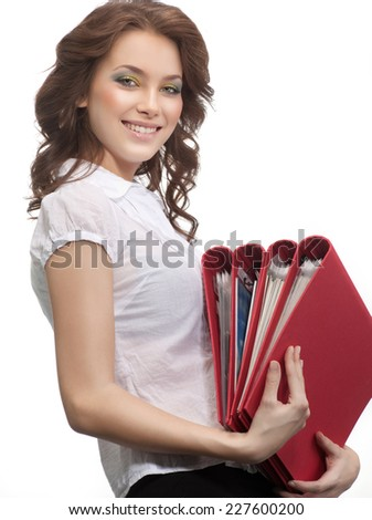 closeup portrait of attractive  caucasian smiling woman brunette isolated on white studio shot  toothy smile  hair head and shoulders looking at camera folders papers businesswoman - stock photo