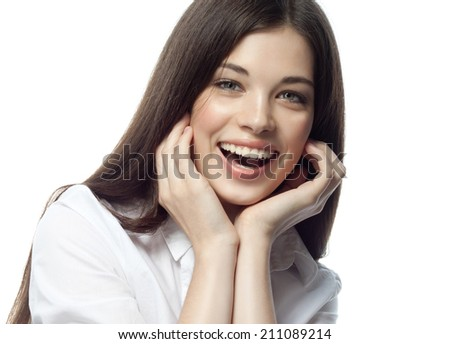 closeup portrait of attractive  caucasian smiling woman brunette isolated on white studio shot lips toothy smile face hair head and shoulders looking at camera tooth businesswoman - stock photo