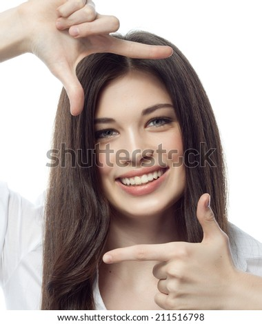 closeup portrait of attractive  caucasian smiling woman brunette isolated on white studio shot lips toothy smile face hair head and shoulders looking at camera tooth hands businesswoman
