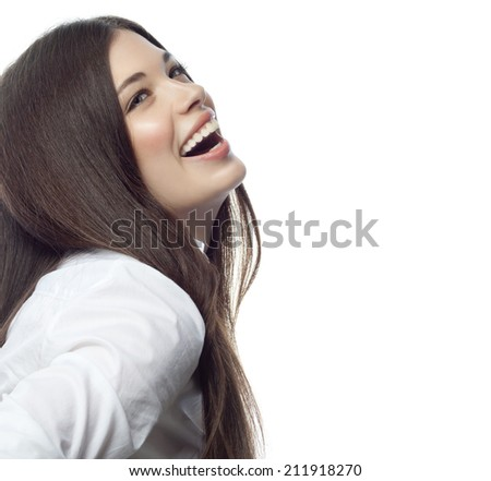 closeup portrait of attractive  caucasian smiling woman brunette isolated on white studio shot lips toothy smile face hair head and shoulders looking up tooth