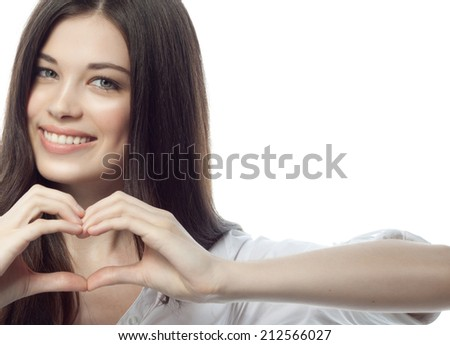 closeup portrait of attractive  caucasian smiling woman brunette isolated on white studio shot lips toothy smile face hair head and shoulders looking at camera tooth businesswoman heart