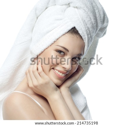 closeup portrait of attractive  caucasian smiling woman brunette isolated on white studio shot lips toothy smile face hair head and shoulders looking at camera tooth towel tube