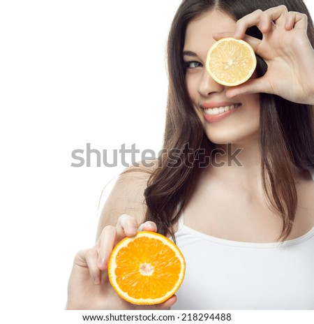 closeup portrait of attractive  caucasian smiling woman brunette isolated on white studio shot lips toothy smile face hair head and shoulders looking at camera orange lemon - stock photo