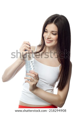 closeup portrait of attractive  caucasian smiling woman brunette isolated on white studio shot lips toothy smile face hair head and shoulders with bottle of water - stock photo