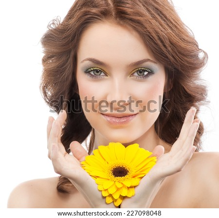 closeup portrait of attractive  caucasian smiling woman brunette isolated on white studio shot lips  face hair head and shoulders looking at camera skin makeup yellow flower spring summer - stock photo
