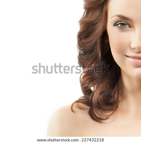 closeup portrait of attractive  caucasian smiling woman brunette isolated on white studio shot lips  smile face hair head and shoulders looking at camera skin makeup yellow flower spring summer - stock photo