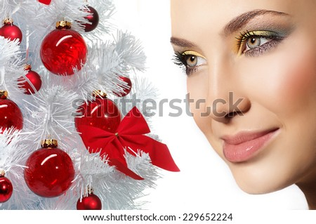 closeup portrait of attractive  caucasian smiling woman brunette isolated on white studio shot lips face closeup  head skin care eyes new year tree christmas - stock photo