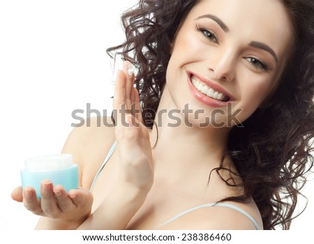 closeup portrait of attractive  caucasian smiling woman brunette isolated on white studio shot lips toothy smile face hair head and shoulders looking at camera tooth applying cream - stock photo