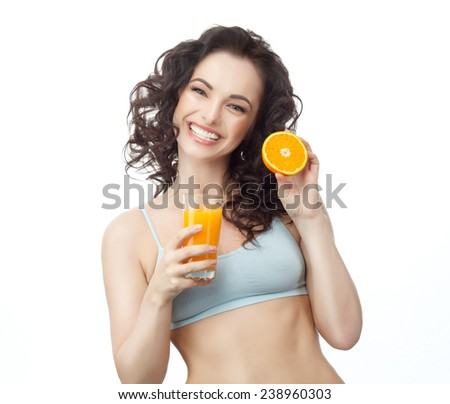 closeup portrait of attractive  caucasian smiling woman brunette isolated on white studio shot lips toothy smile face hair head and shoulders looking at camera tooth drinking orange juice