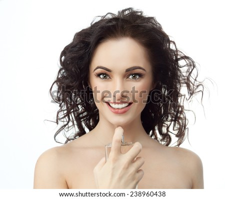 closeup portrait of attractive  caucasian smiling woman brunette isolated on white studio shot lips toothy smile face hair head and shoulders looking at camera applying perfume - stock photo