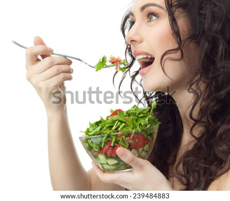 closeup portrait of attractive  caucasian smiling woman brunette isolated on white studio shot lips toothy smile face hair head and shoulders eating salad