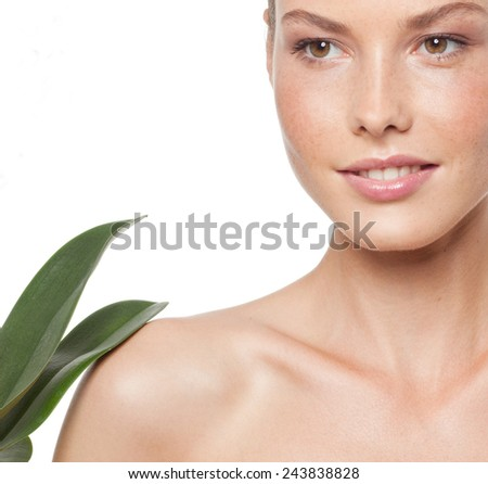 closeup portrait of attractive  caucasian smiling woman brunette isolated on white studio shot lips  face head and shoulders flower - stock photo