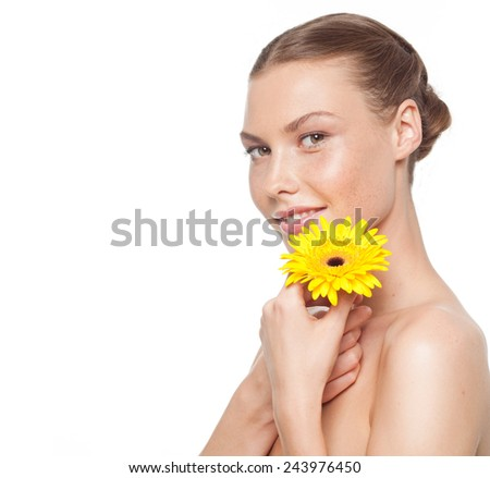 closeup portrait of attractive  caucasian smiling woman brunette isolated on white studio shot lips  face head and shoulders looking at camera yellow flower - stock photo