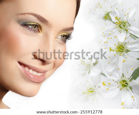 closeup portrait of attractive  caucasian smiling woman brunette isolated on white studio shot lips toothy smile face closeup makeup head  tooth eyes spring flowers - stock photo
